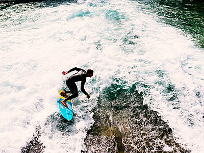 River surfing - p1177m2111452 by Philip Frowein