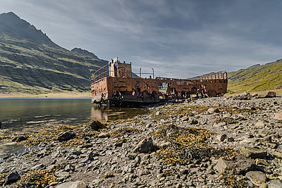 Mjoifjordur fjord wrecked boat - p1487m1564206 by Ludovic Mornand