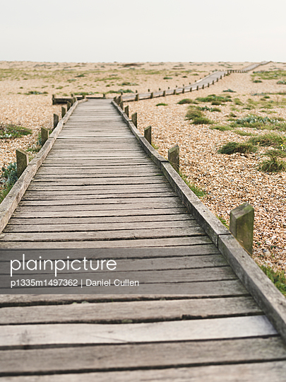 Wooden Boardwalk over Pebble Beach - p1335m1497362 by Daniel Cullen