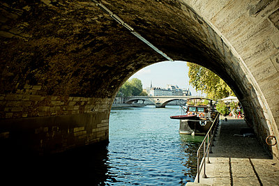 Under a bridge of Paris - p445m1183654 by Marie Docher