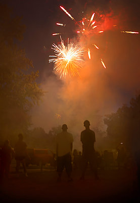 People watching fireworks in night sky - p555m1454208 by Chris Clor