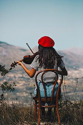 Girl playing violin  - p1623m2212032 by Donatella Loi