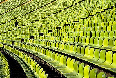 Germany, Bavaria, Munich, View of green seats in olympic stadium - p300m879128 by Paul Seheult