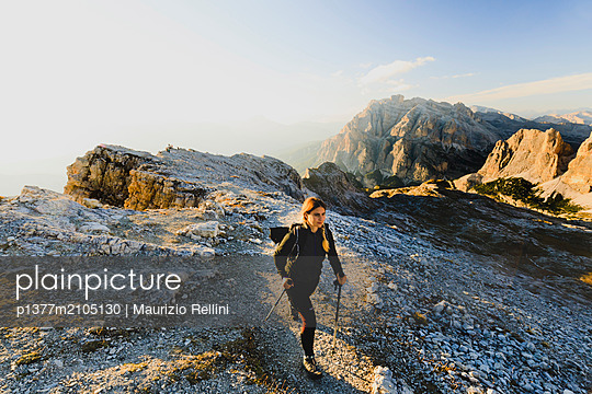 Italy, Veneto, Belluno district, Alps, Dolomites, Dolomiti Bellunesi National Park, Woman hiking on the top of Lagazuoi mountain in the Belluno Dolomites near Cortina d'Ampezzo - p1377m2105130 by Maurizio Rellini