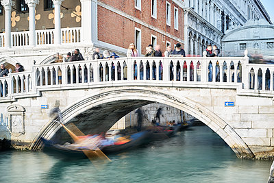 Gondola under a bridge - p1312m2082172 by Axel Killian
