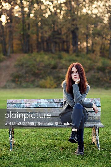 The girl on the Park bench - p1412m2132885 by Svetlana Shemeleva