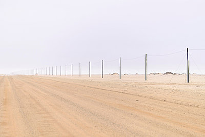 Africa, Namibia, Namib Naukluft area, Dirts track and power lines - p300m950353f by Hartmut Loebermann