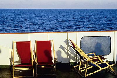 Deck chairs on boat - p1418m1571495 by Jan Håkan Dahlström