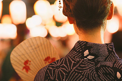 Young Japanese woman in a traditional kimono at a summer festival - p307m935866f by Yosuke Tanaka