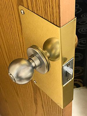 Brass security door handle  - p1048m2025417 by Mark Wagner