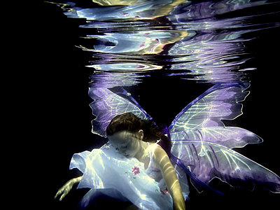 Fallen Butterfly Child Underwater - p1019m816925 by Stephen Carroll