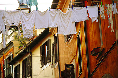 Laundry hanging on clothes line - p9240368 by gmazzarini.com