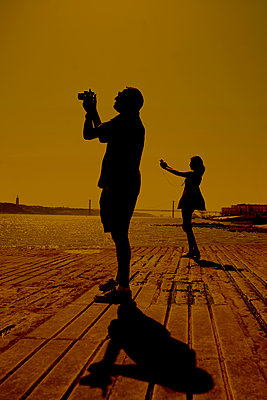 Taking pictures, Cais das Colunas, Tagus River, Lisbon, Portugal - p1028m1588885 by Jean Marmeisse