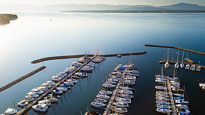 Aerial view of marina on Lake Geneva in Prangins with lots of boats - p343m1475922 by Raffi Maghdessian