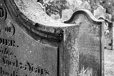 Black and white image of old headstones in a graveyard - p1302m2055469 by Richard Nixon