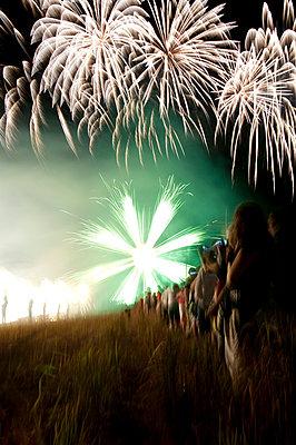 Fireworks over audience - p567m720720 by Sandrine Agosti Navarri