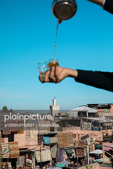 Marrakesh, Pouring tea in  - p1253m2152621 by Joseph Fox