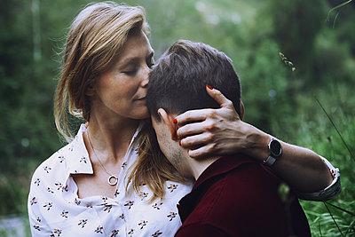 Happy couple having fun outdoors - p1577m2150282 by zhenikeyev