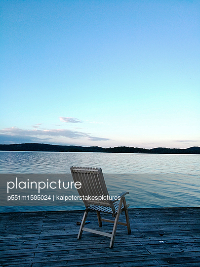 Folding chair on landing stage - p551m1585024 by kaipeterstakespictures