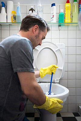Cleaning the toilet - p383m987727 by visual2020vision