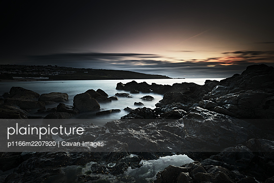 Long Exposure, Rocks, Setting Sun - p1166m2207920 by Cavan Images