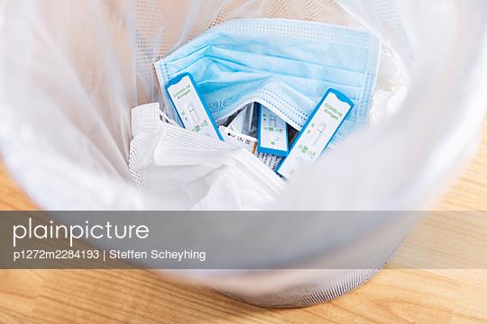 Covid Test Kit in Trash - p1272m2284193 by Steffen Scheyhing