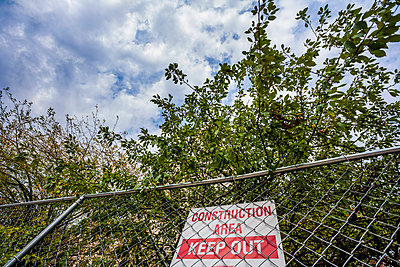 Sign on a chain-link fence reading - p1072m993325 by Peter Glass
