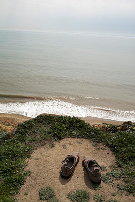 Shoes on edge of cliff - p388m701933 by Andre