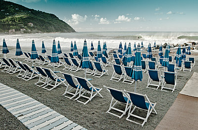 Deck chairs on beach - p416m1056945 by Andy Fox