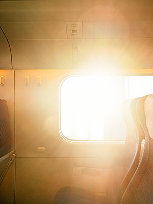 Backlit, Riding the train - p1177m2090562 by Philip Frowein