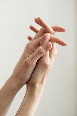 Folded hands of woman - p1041m1042350 by Franckaparis