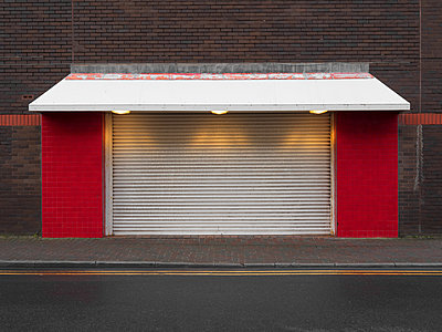 Illuminated shop front - p1280m2152535 by Dave Wall