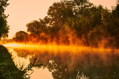 Trees and river at sunset - p1312m2262371 by Axel Killian