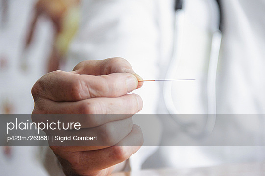Close up of doctor holding needle