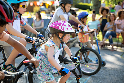 Girl ready for bike race at starting line - p1192m2017003 by Hero Images