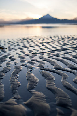 Close-up of the ripples and tide pools on the shores of the tidal flats at sunset; Homer, Alaska, United States of America - p442m1482911 by Scott Dickerson