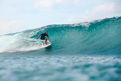 Surfer riding wave,Sumbawa, Indonesia - p1166m2202328 by Konstantin Trubavin