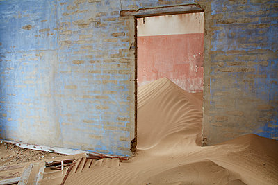 Interior of an abandoned building full of sand. - p1100m1489988 by Mint Images