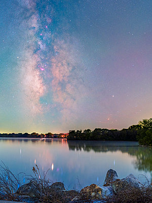 Scenic view of lake against starry sky - p1166m1533868 by Cavan Social