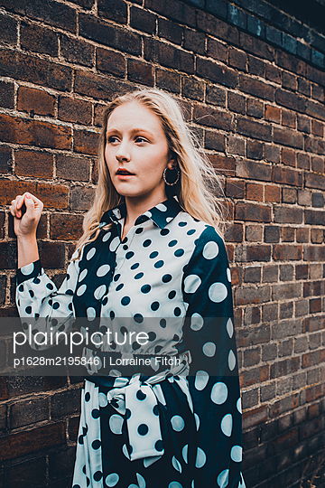 Blonde woman in spotty dress - p1628m2195846 by Lorraine Fitch