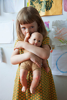 Girl with doll  - p1040m1195496 by Dorothee Hörstgen