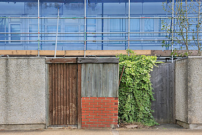 Re-using wood panels for social housing fence - p1048m1417516 by Mark Wagner