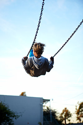 Boy on Swing - p1260m1073027 by Ted Catanzaro