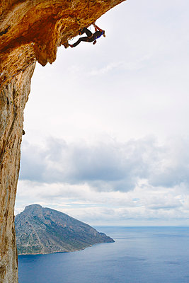 Greece, Dodecanese, Kalymnos, Rock climber on steep cliff - p352m1062099f by Eija Huhtikorpi