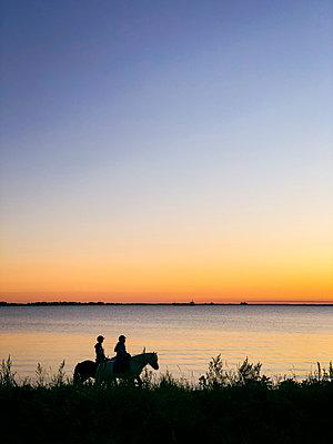 Horse ride on the beach - p382m2283967 by Anna Matzen