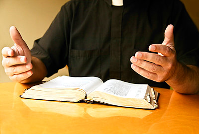 A priest reading the Bible - p4426014f by Design Pics