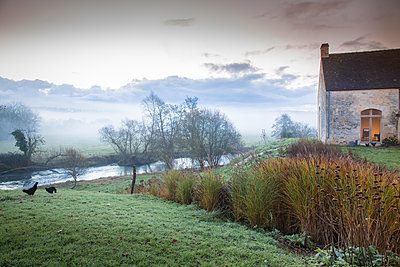 France, Wintry river landscape with an old country house - p948m2222834 by Sibylle Pietrek