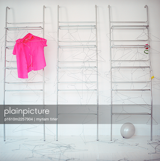 A room empty of clothes - p1610m2257904 by myriam tirler