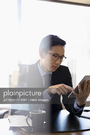 Male lawyer using digital tablet in conference room