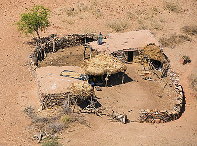 Ethiopia, Tigray Region, Gheralta.  A typical Tigrayan homestead whose dwelling houses have stone walls and flat, earth-covered roofs. Crops are often dried or stored on these roofs or on those of the outbuildings. - p652m1166935 by Nigel Pavitt
